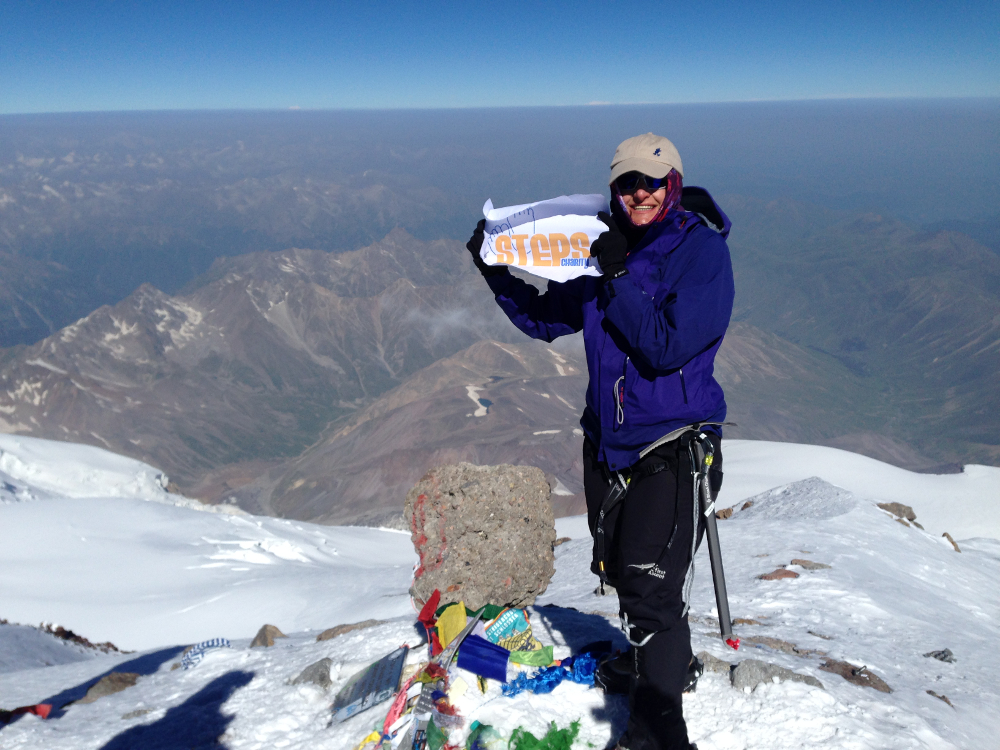 Cheryl on the summit of Mount Elbrus last year